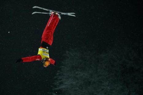 Китаец Сю Менао, 1 место среди мужчин. Фото: NATALIA KOLESNIKOVA/AFP/Getty Images