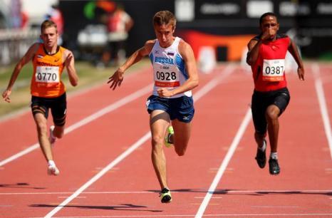 Мировой рекорд поставил Андрей Вдовин в беге на 100 метров в классе Т37 на Чемпионате мира по лёгкой атлетике во французском Лионе 23 июля 2013 года. Фото: Julian Finney/Getty Images