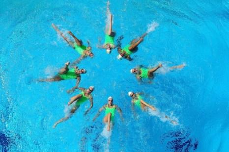 Синхронное плавание. Выступление австралийской Олимпийской  команды 2012 года. Фоторепортаж. Фото: Chris Hyde/Getty Images