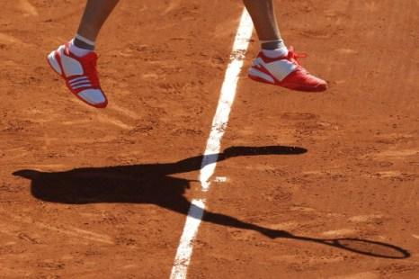Каролин Возняцки и Новак Джокович вышли в третий круг открытого чемпионата Франции.  Фоторепортаж с «Ролан Гаррос». Фото: Clive Brunskil/Matthew Stockman/JACQUES DEMARTHON/AFP/Getty Images