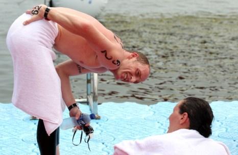 Фоторепортаж  с  соревнований по 5-километровому  заплыву в команде из трех человек. Фото:  Clive Rose /Adam Pretty/Getty Images