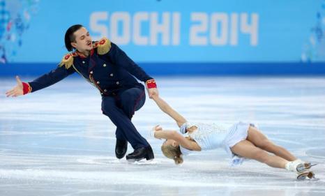 Татьяна Волосожар и Максим Траньков выступают с короткой программой 11 февраля в ходе сочинской Олимпиады. Фото: Paul Gilham/Getty Images