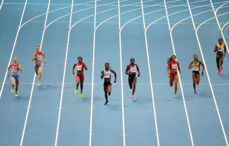 Российская бегунья Антонина Кривошапка 12 августа 2013 года в упорной борьбе финишировала третьей на дистанции 400 метров в московских «Лужниках» на ЧМ по лёгкой атлетике. Фото: LOIC VENANCE/AFP/Getty Images