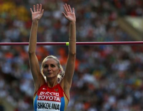 Россиянка Светлана Школина смогла взять высоту 2 метра 3 сантиметра, установив личный рекорд в карьере на чемпионате мира в московских «Лужниках» 17 августа 2013 года. Фото: ADRIAN DENNIS/AFP/Getty Images