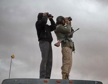Бойцы ливийской оппозиции. Фото РИА Новости