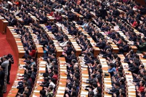 Делегаты на закрытии сессии Всекитайского собрания народных представителей (ВСНП) в Большом народном зале 17 марта в Пекине. Фото: AFP/Getty Images