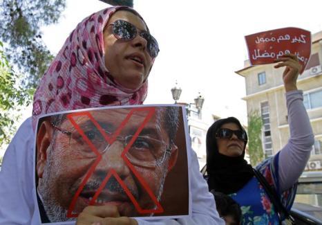 Около 17 миллионов человек вышли на площади Египта 30 июня 2013 года, требуют свержения президента Мухаммеда Мурси. Фото: LOUAI BESHARA/AFP/Getty Images