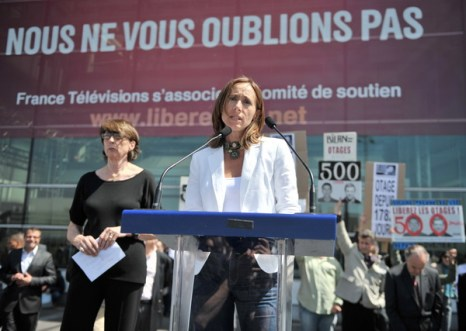 Фоторепортаж с митинга в поддержку двум похищенным в Афганистане французским журналистам. Фото: AFP PHOTO/BERTRAND LANGLOIS