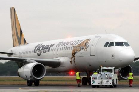 Осложняются отношения международных авиакомпаний с Европой. Самолет Сингапурской авиакомпании Tiger Airways. Фото:  ROSLAN RAHMAN/AFP/Getty Images