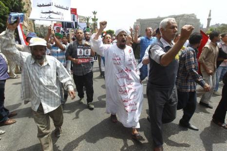 Акция протеста «Пятница наступления» рядом со зданием Министерства обороны на площади Тахрир в Каире. Фоторепортаж. Фото:  KHALED DESOUKI/AFP/GettyImages