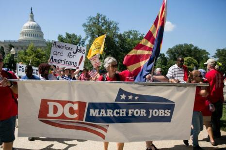 В Вашингтоне прошёл марш против нелегальной иммиграции, который закончился митингом у Капитолия 15 июля 2013 года. Фото: Drew Angerer/Getty Images