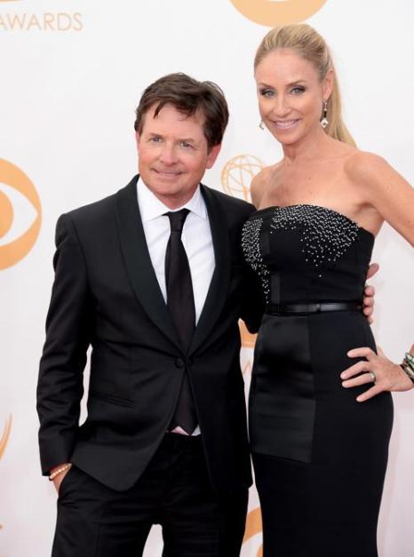 Актёры Майкл Дж. Фокс и Трейси Поллан прибыли на 65-ю ежегодную церемонию вручения наград «Эмми», которая состоялась в голливудском театре «Нокиа» 22 сентября 2013 года в Лос-Анджелесе, Калифорния (США). Фото: Jason Merritt/Getty Images