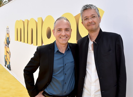 """LOS ANGELES, CA - JUNE 27:  Directors Kyle Balda (L) and Pierre Coffin arrive at the premiere of Universal Pictures and Illumination Entertainment's """"Minions"""" at the Shrine Auditorium on June 27, 2015 in Los Angeles, California.  (Photo by Kevin Winter/Getty Images)"""