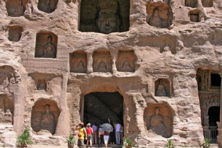 Tourist-entering-one-of-the-caves-in-the-Yungang-Grottoes-shutterstock_195695717-WEBONLY