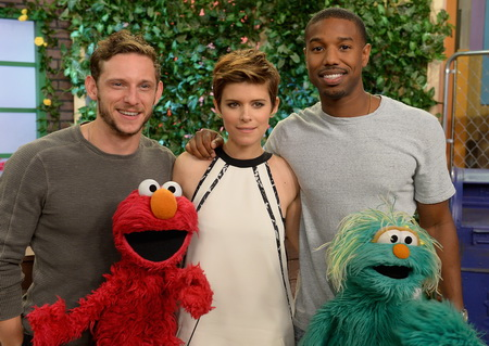 """MIAMI, FL - JULY 31:  Jamie Bell, Kate Mara, Michael B. Jordan are seen Sesame Street characters Elmo and Rosita on the set of Despierta America to promote the film """"Fantastic Four"""" at Univision Studios on July 31, 2015 in Miami, Florida.  (Photo by Gustavo Caballero/Getty Images)"""