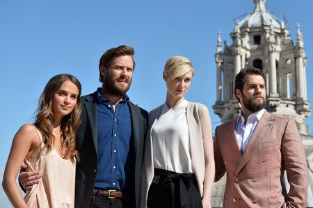 """(FromL) Swedish actress Alicia Vikander, US actor Armie Hammer, Australian actress Elizabeth Debicki and British actor Henry Cavill pose during a photocall for the film """"The Man from U.N.C.L.E''  directed by Guy Ritchie in Rome on May 9, 2015.  AFP PHOTO / TIZIANA FABI        (Photo credit should read TIZIANA FABI/AFP/Getty Images)"""