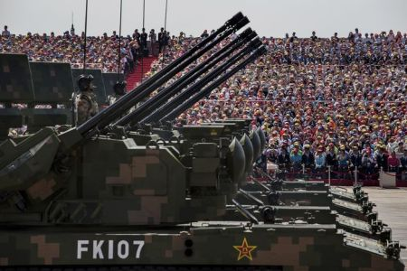 BEIJING, CHINA - SEPTEMBER 03: Chinese soldiers ride in armoured vehicles as they drive in front of Tiananmen Square and the Forbidden City during a military parade on September 3, 2015 in Beijing, China. China is marking the 70th anniversary of the end of World War II and its role in defeating Japan with a new national holiday and a military parade in Beijing. (Photo by Kevin Frayer/Getty Images)