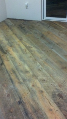 Picture of Rough Cut Reclaimed Barn Board Floor Before Installation of Clear Epoxy