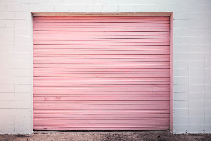 a pink colored garage door