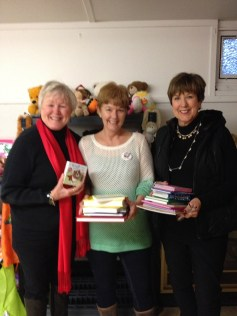 Giving books we collected to Santa House