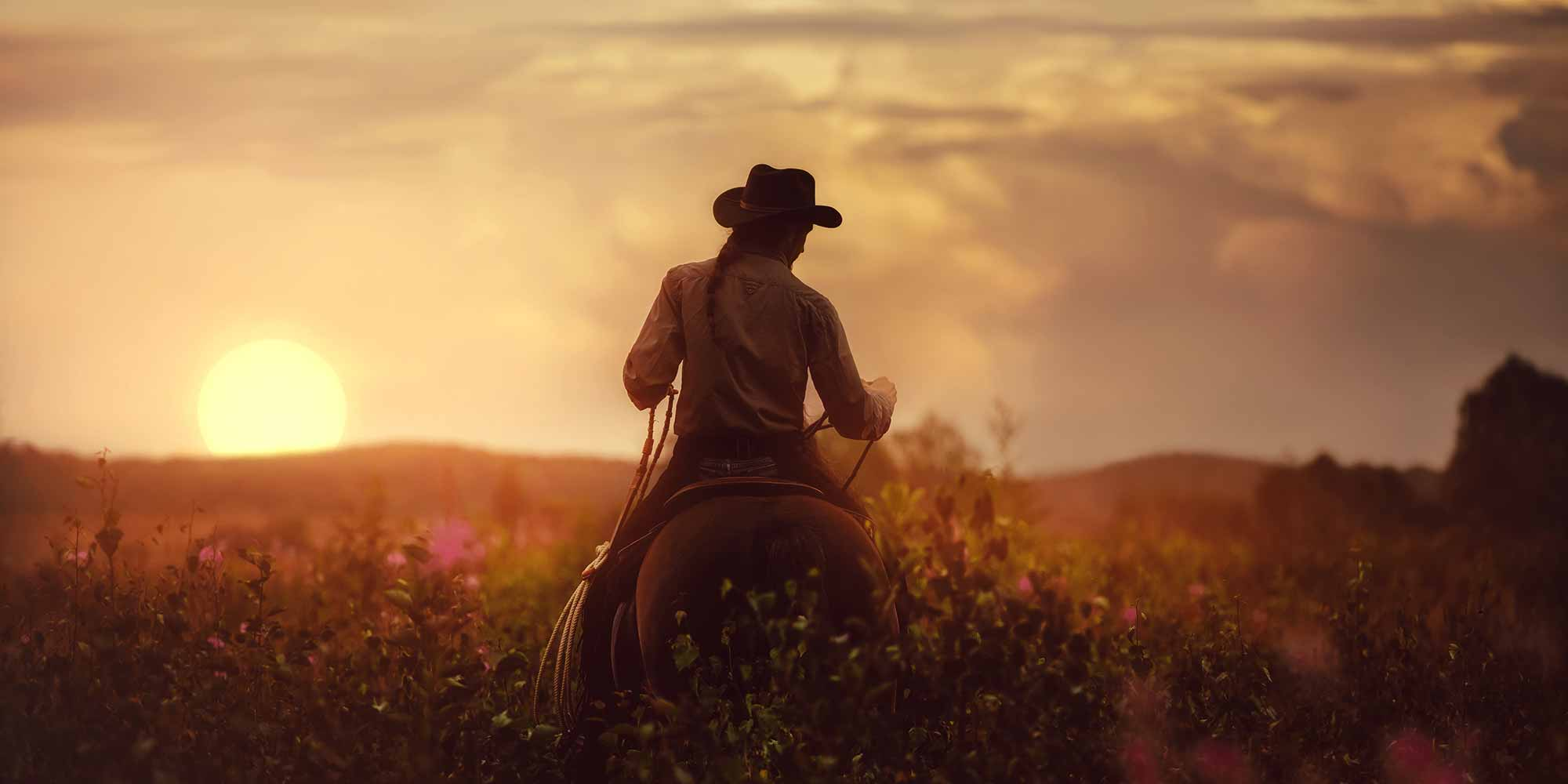 EQ Graphics | Western Cowgirl Horseback Riding Into The Wyoming Sunset Photography