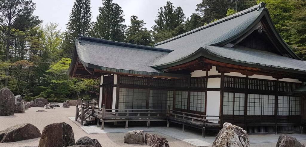 Koyasan Wakayama building Japan temple with stones on white swept sand