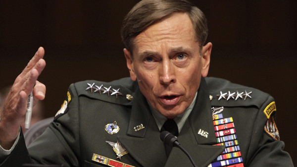 General David Petraeus gestures during the Senate Intelligence Committee hearing in Washington