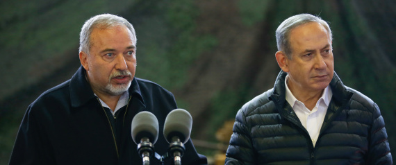 Israel's Defense Minister Avigdor Lieberman speaks as Israeli Prime Minister Benjamin Netanyahu stands next to him during a visit to an army base in the West Bank settlement of Beit El near Ramallah January 10, 2017. REUTERS/Baz Ratner