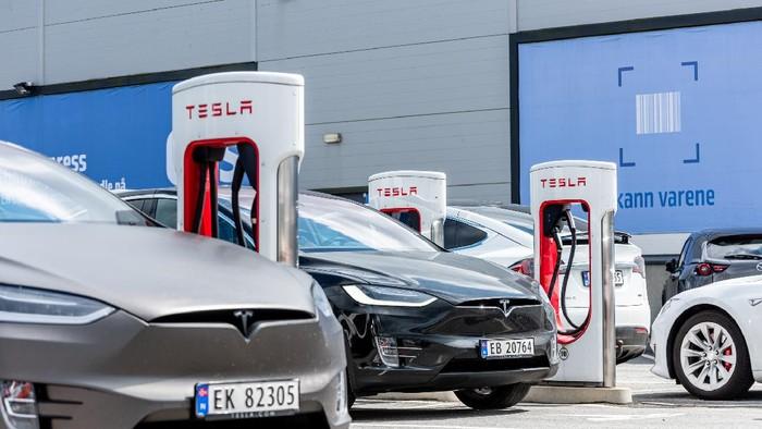 Lyngdal, Norway - August 02 2021: Tesla Superchargers at use at Handelsparken.