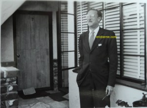 Eric Berne outside holding his pipe, circa 1960s