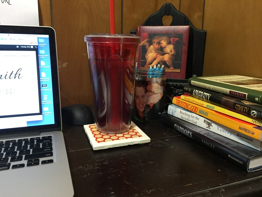 My desk during the Lenten season - a depository of books on brokenness.