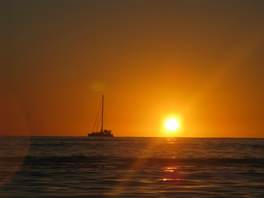 Boat Past the Sunset