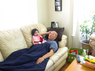 Scarlett Sitting on Grandpa