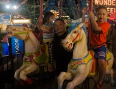Anh Dat with Nam and Lan on the carousel