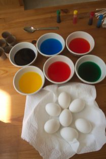 The colors are ready for Scarlett to dip the eggs in.