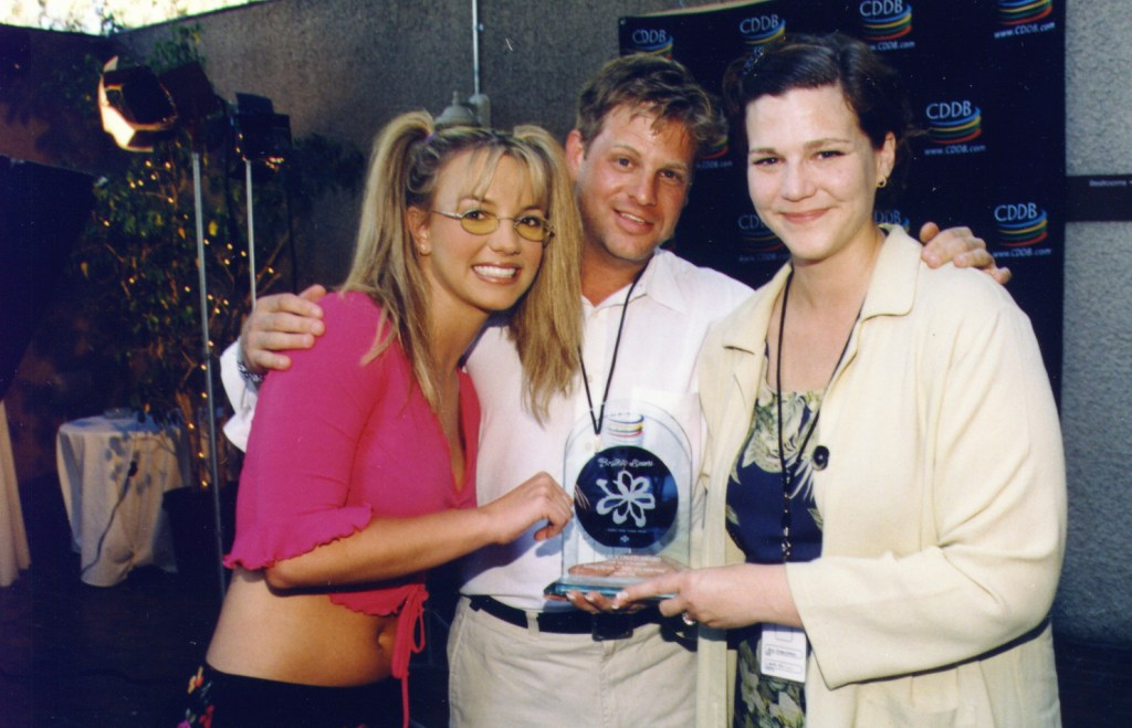 Awarding the Silicon CD to Britney Spears for most played artist on the net. I created the award for my client Gracenote.