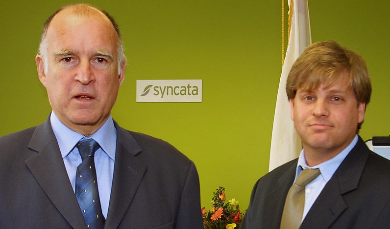 With then California State Governor Jerry Brown at press event in Oakland California.