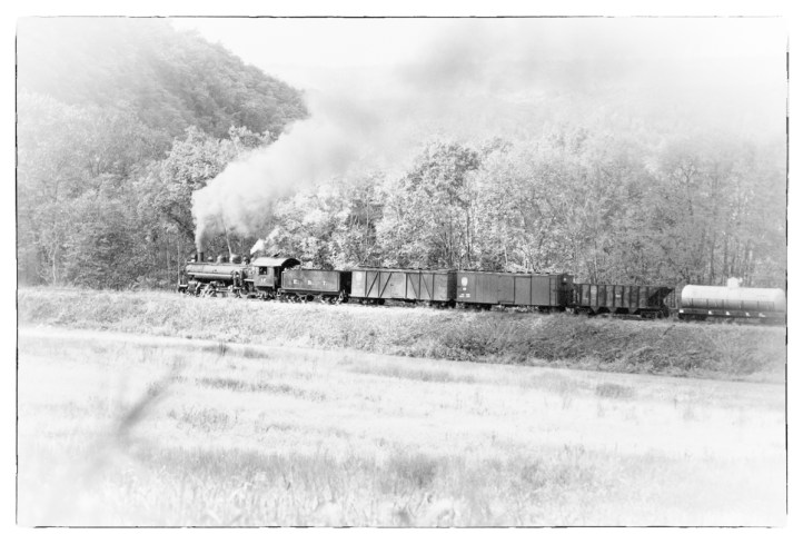 """A """"freight"""" train crosses the long fill heading towards Orbisonia."""