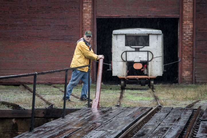 A FEBT crewman aligns the turntable for another speeder to roll into the roundhouse.