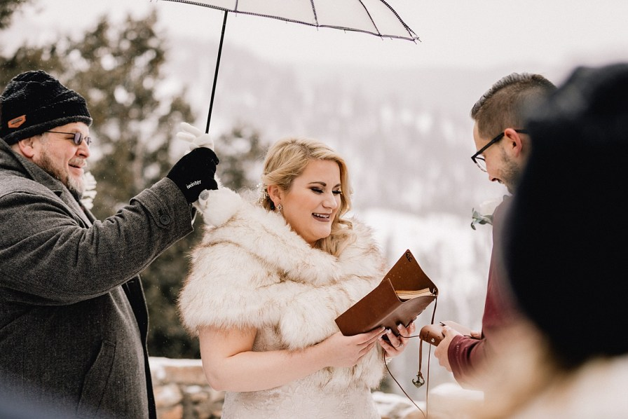 Bride reads her vows at Sapphire point elopement