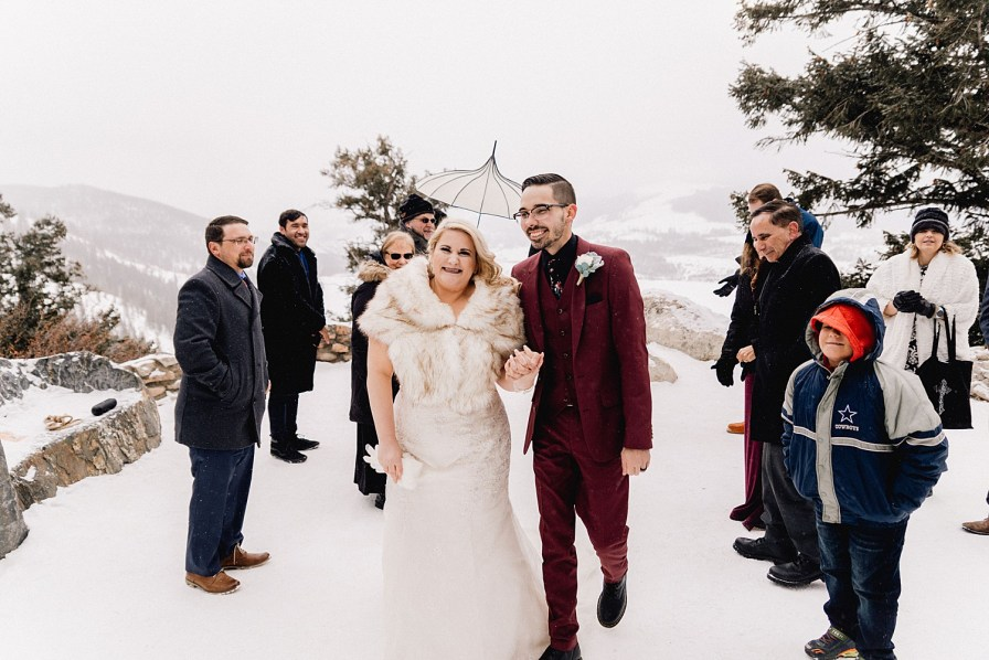 Couple exits their snowy Sapphire Point elopement