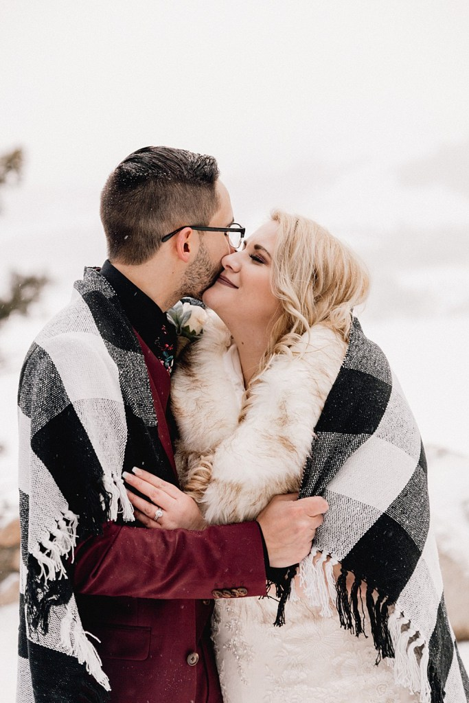 Snuggly blanket photos at Sapphire Point elopement