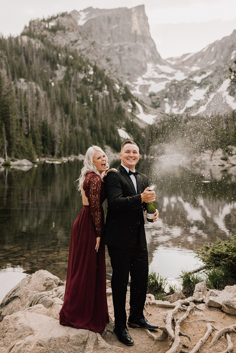 popping champagne for rmnp engagement photos