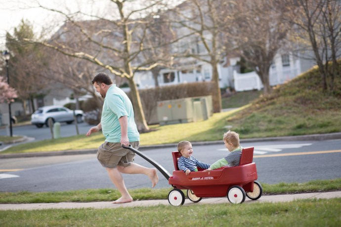dad pulling two boys in wagon