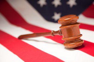 Rhode Island insurance denied attorney gavel and flag