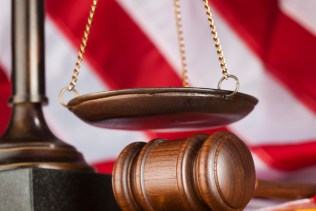 New England disability claims law firm gavel scale