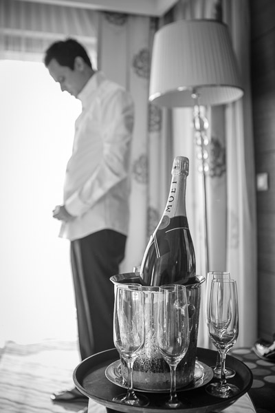 Groom getting ready and a bottle of champagne