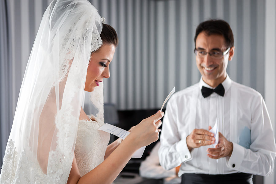 bride and groom reading their letters to each other