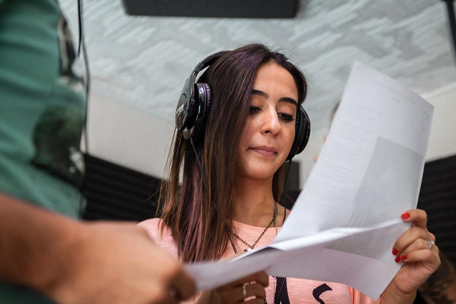 girl checking the lyrics in recording studio