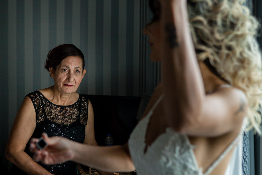 mother looking at the bride